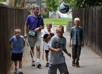 Mike walking with a group of boys after his surgery