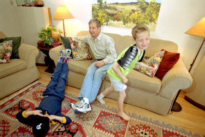 Mike and boys playing in living room after surgery
