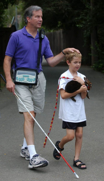 Mike walking with Carson after surgery